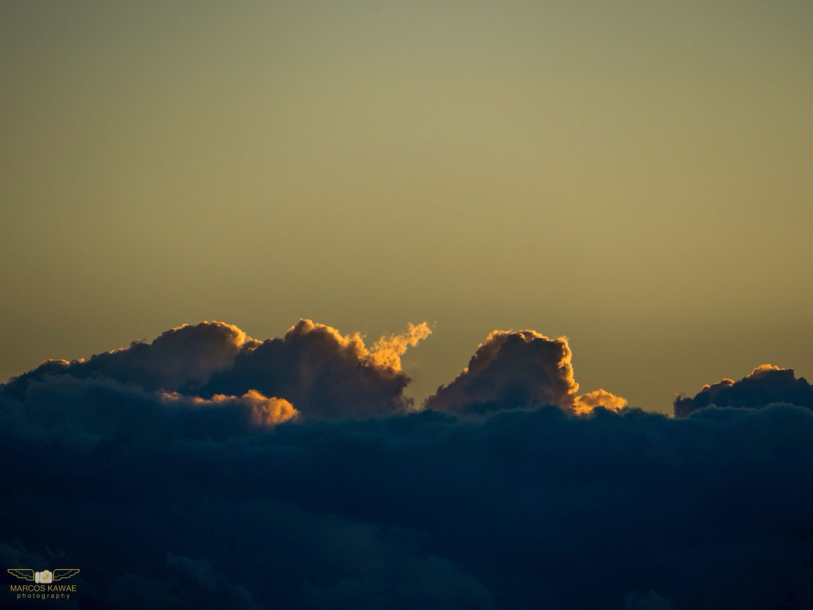 scenics, beauty in nature, tranquil scene, sky, tranquility, sunset, copy space, nature, silhouette, idyllic, cloud - sky, mountain, dusk, weather, outdoors, cloudscape, majestic, no people, low angle view, cloud
