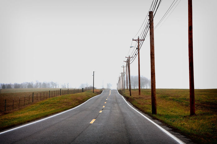 Out Away From It Transportation The Way Forward Tennessee Telegraph Pole Straight Road Sky Road Overcast Outdoors Open Sky Open Road No People Nature Lush Landscape Horizon Grass Fence Diminishing Perspective Day Copy Space Blacktop Black Top Forward EyeEmNewHere