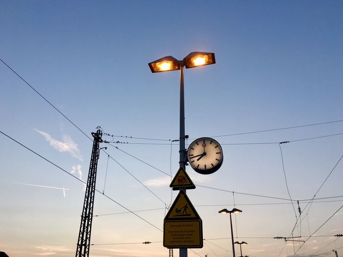 Low Angle View Lighting Equipment Electricity  Sky No People Connection Technology Illuminated Outdoors Time Clock Day
