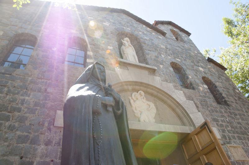 "Statue in ""La Maternidad de Maria"" Chapel - Santiago - Chile Chile La Maternidad De Maria Statue Built Structure Lens Flare Religion San Cristobal San Cristobal Hill Sanctuary  Santiago Sunlight"