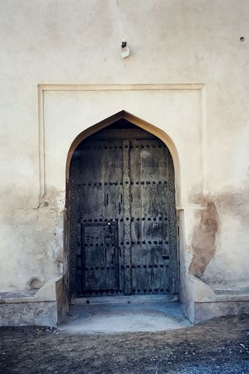 old door of the Bait Na'aman Fortress, Oman... Architecture Barkā' Historical Building Historical Monuments Historical Sights History Through The Lens  Oman Arch Architecture Built Structure Day Door Doorway Entrance Entry Historic Historic Building Historical Historical Place History History Architecture Indoors  No People Oman_photography Open Door