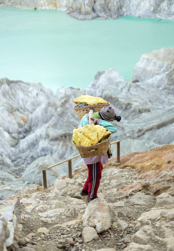 Miner is carrying basket of sulfur at Kawah Ijen,Indonesia Rock Solid Nature Art And Craft Yellow Creativity Outdoors Sulphur Sulfur Rock Sulfur  Rock - Object Kawah Ijen Yellow Stone Lake View Miner INDONESIA Volcano Land Travel Photography Mountain View Java Gas Nature Photography Crater Turquoise