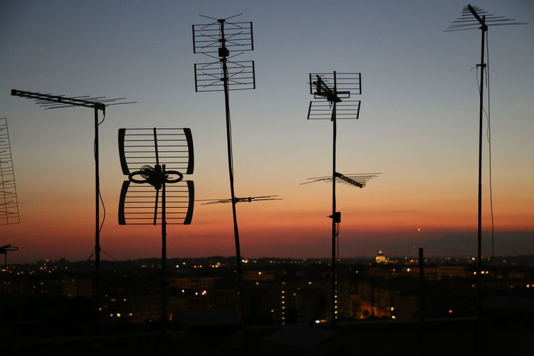 Low angle view of antennas against the sky