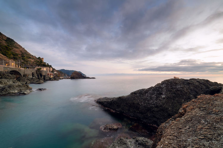 Framura, little village on east Ligurian coast Beauty In Nature Water Scenics - Nature Sky Sea Rock Cloud - Sky Rock - Object Tranquility Rock Formation Nature Tranquil Scene Solid Idyllic No People Mountain Non-urban Scene Beach Outdoors Formation Rocky Coastline Framura Liguria Italy Mediterranean