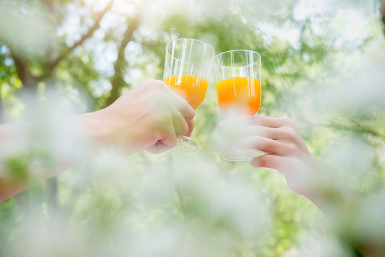 Close-up Day Drink Drinking Glass Food And Drink Freshness Holding Human Body Part Human Hand Nature One Person Outdoors People Real People Refreshment Tree Young Adult Young Women