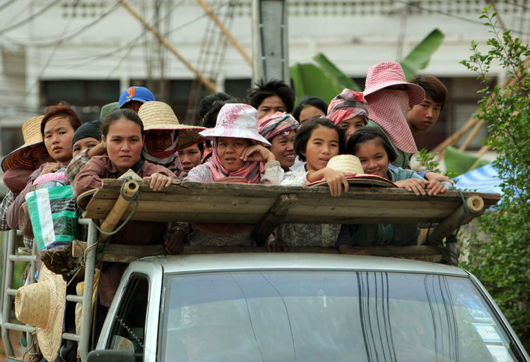 Boys And Girls Traveling In Pick-Up Truck