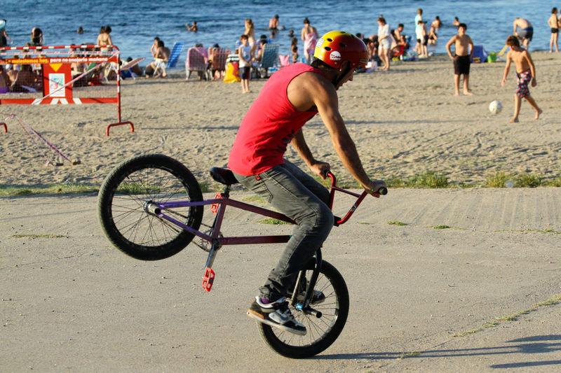 Man Riding Bicycle At Beach