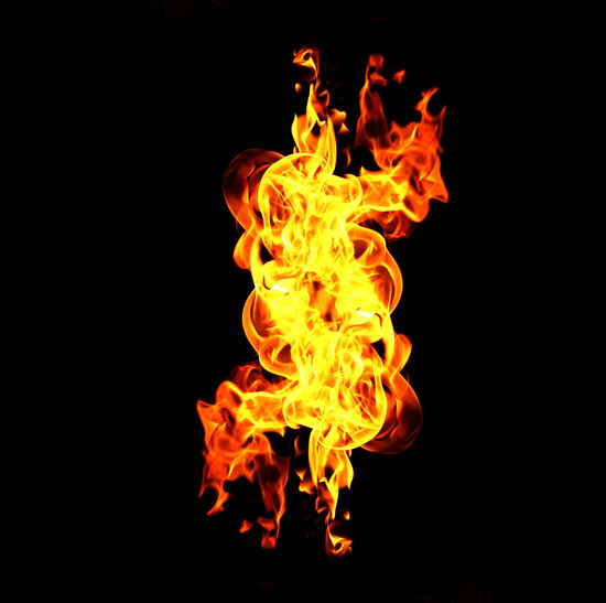 Close-up of fire against black background