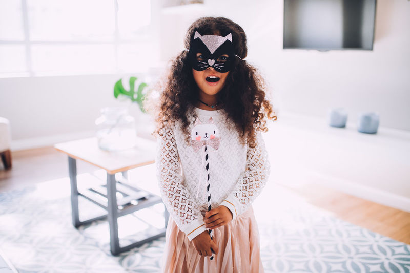 5 Years Old Afro Children Fun Halloween Happiness Happy Home Kids Life Princess TheWeekOnEyeEM Afrohair Cat Child Childhood Costume Girl Kid Little Girl Living Room Mask
