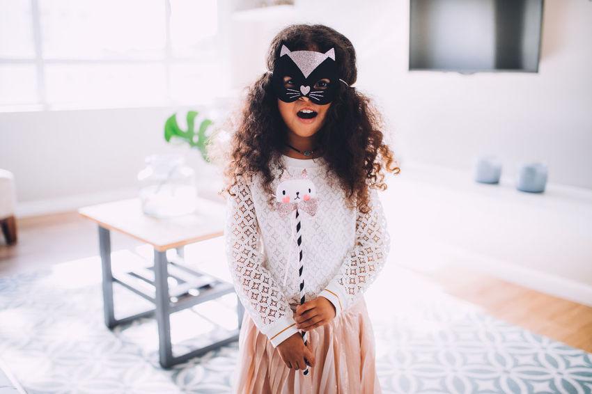 5 Years Old Afro Children Fun Halloween Happiness Happy Home Kids Life Princess TheWeekOnEyeEM Afrohair Cat Child Childhood Costume Girl Kid Little Girl Living Room Mask