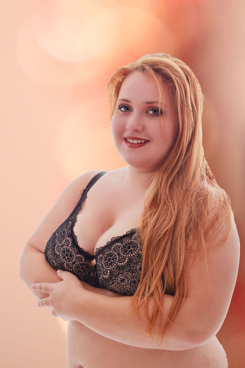 Portrait of a beautiful and curvy woman in lingerie on a colored background Bustywomen Colors Curves Diet Fashion Oversized Overweighted Plus Size Model Redhead Abdomen Backgrounds Bra Curvy Leisure Activity Lifestyles Lingerie One Person Overweight Real People Sexygirl Underwear😈 Weight Women Young Adult Young Women