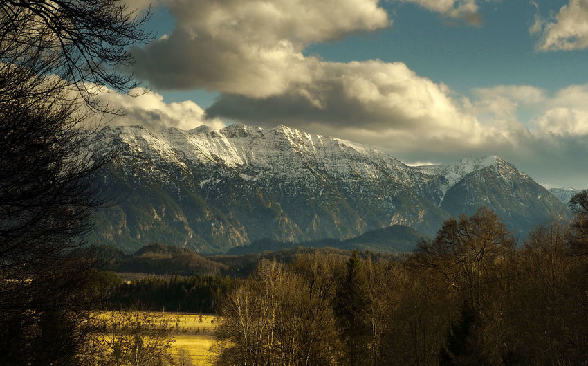 Alps Bayern Germany Beauty In Nature Beauty In Nature Cloud - Sky Day Dramatic Sky Hanging Out Landscape Mountain Mountain Peak Mountain Range Nature No People Outdoors Purenature Scenics Sky Snow Taking Photos Tree