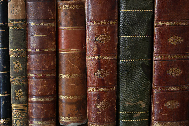 old books piled on a wooden table Antique Bookshelf Bookshelfs Horizontal Learning Library Read Reading Book Close Up Collection Cover Culture Education History Leather Library Literature Old Piled Publication Reading A Book Still Life Traditional Wood - Material