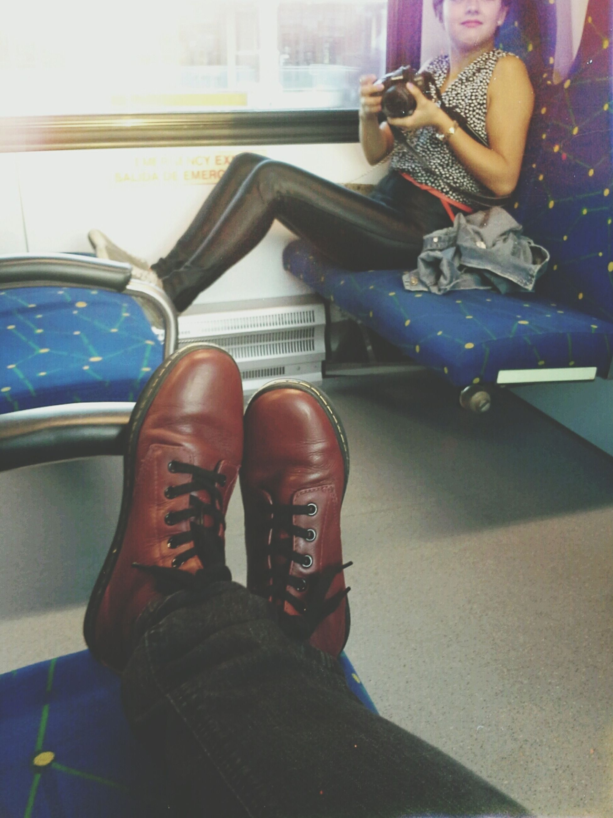 low section, person, shoe, lifestyles, footwear, sitting, personal perspective, leisure activity, human foot, part of, men, jeans, standing, day, high angle view, transportation