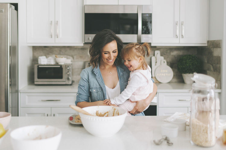 Mother and daughter in kitchen at home