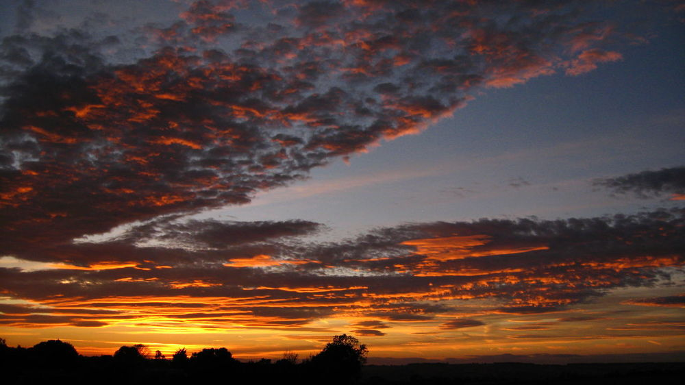 Dramatic Sunset over The Cotswolds Beauty In Nature Beauty In Nature Clouds Colourful Cotswold Dramatic Dramatic Sky Dramatic Sky Idyllic Landscape Landscape_Collection Moody Sky Nature No People Orange Orange Color Rural Landscape Scenics Silhouette Sky Sky And Clouds Sunset The Cotswolds Vibrant Color Weather
