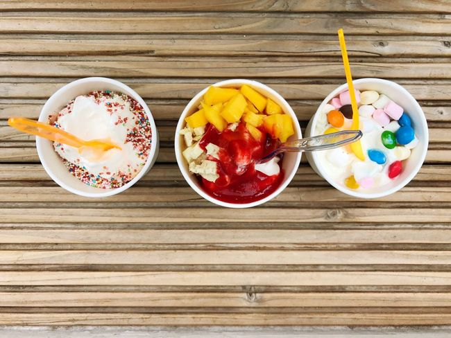 Top View Ice Cream Frozen Yogurt Frozen Food Selection Food And Drink Bowl Wood - Material Table Freshness Indulgence Breakfast Food Sweet Food No People Yogurt Ready-to-eat Multi Colored