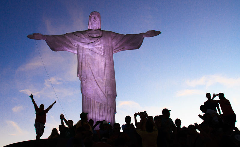 Cristo Redentor at Corcovado at dusk. Christ the Redeemer is an Art Deco statue of Jesus Christ in Rio de Janeiro, Brazil, created by Polish-French sculptor Paul Landowski and built by the Brazilian engineer Heitor da Silva Costa, in collaboration with the French engineer Albert Caquot. Brasil Bucketlist Corcovado Corcovado National Park Cristo Redentor Rio De Janeiro Riodejaneiro Sculpture Seven Wonders Of The World Top Of The World Tourism Travel Travel Destinations