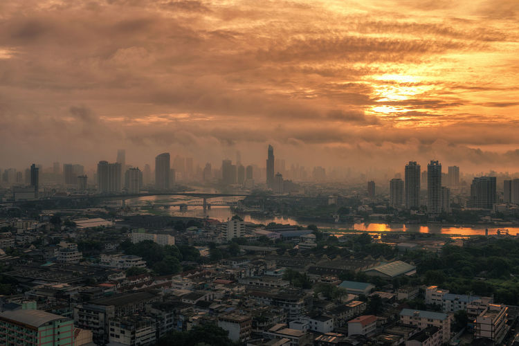 View of Bangkok cityscape and Chao Phraya River in the morning. Bangkok Thailand. Architecture Building Exterior Built Structure City Cityscape Cloud - Sky Crowded Day Downtown Modern Outdoors Sky Skyline Skyscraper Sunset Tall Travel Destinations Urban Skyline
