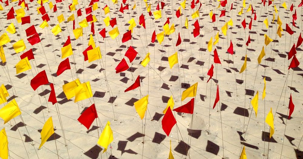 Red and Yellow Flags: Sculpture by the sea Detail Western Australia Sculptures By The Sea Summer Sculpture Perth Outdoors Expressive Sculpture Cottesloe Beach Colors Art Event Art Abstract Flags Flag Art Flags On Beach Red Yellow Pattern Flag Pattern Sand Artistic Perth Art Event Abstract Sculpture