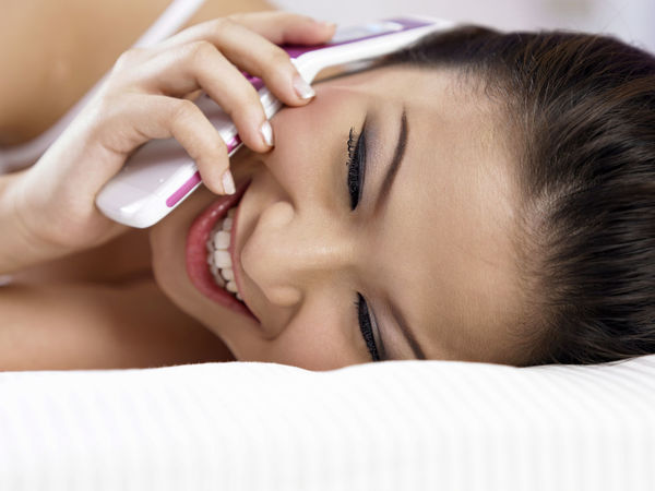 cheerful asian woman using mobilephone At Home Beautiful Bed Laughing Mobile Phone Beautiful Woman Bedroom Charting Communication Connection Handphone Indoors  Leisure Activity Lifestyles Lying Down One Person Portrait Real People Relaxation Talking Technology Wireless Technology Young Adult Young Women