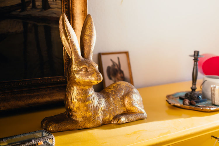 Close-up of animal statue on table at home