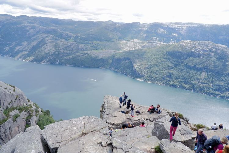 High angle view of people on rocks against mountains