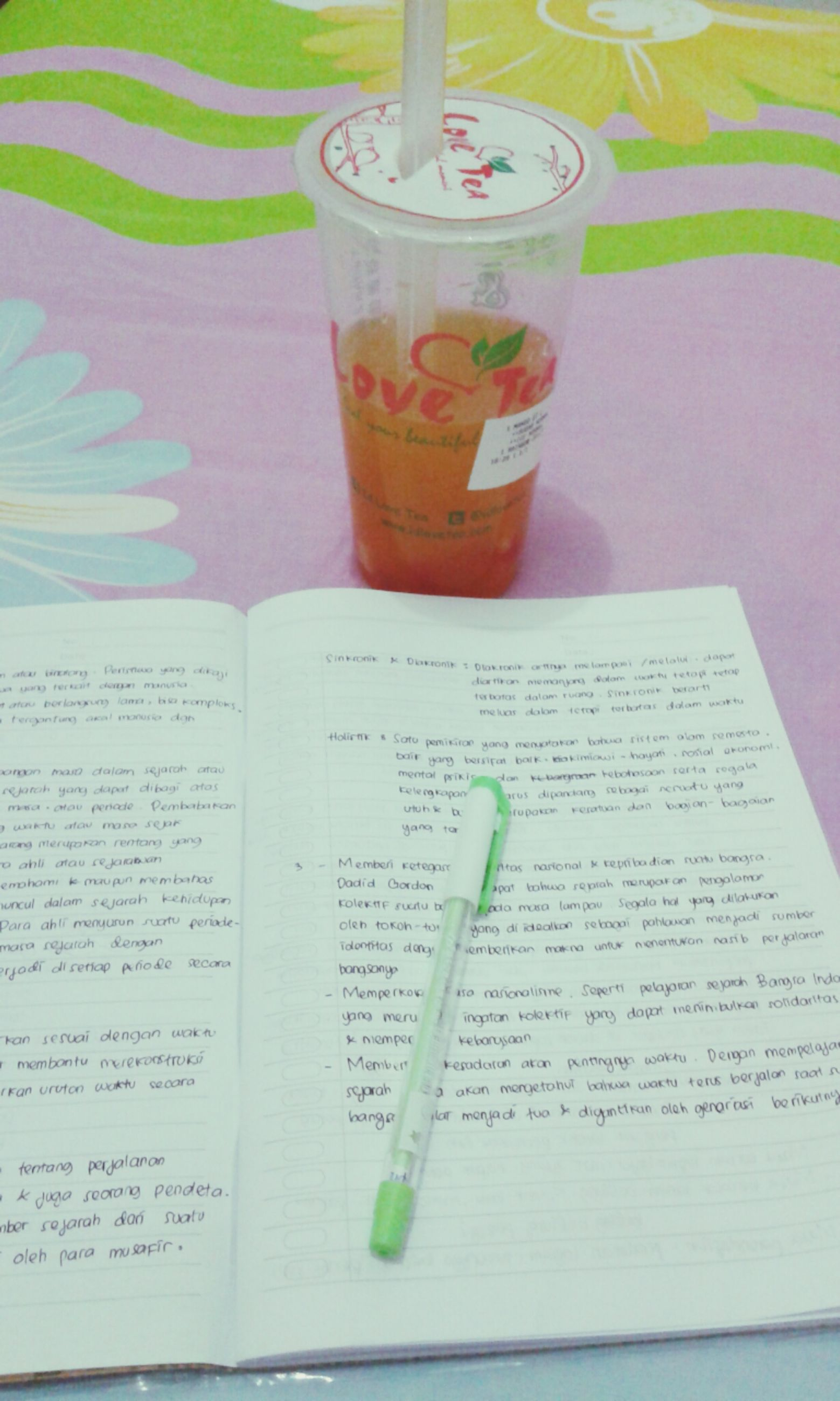 indoors, table, drink, still life, text, food and drink, western script, refreshment, close-up, freshness, book, communication, paper, education, drinking glass, high angle view, no people, glass - material, handwriting, pen