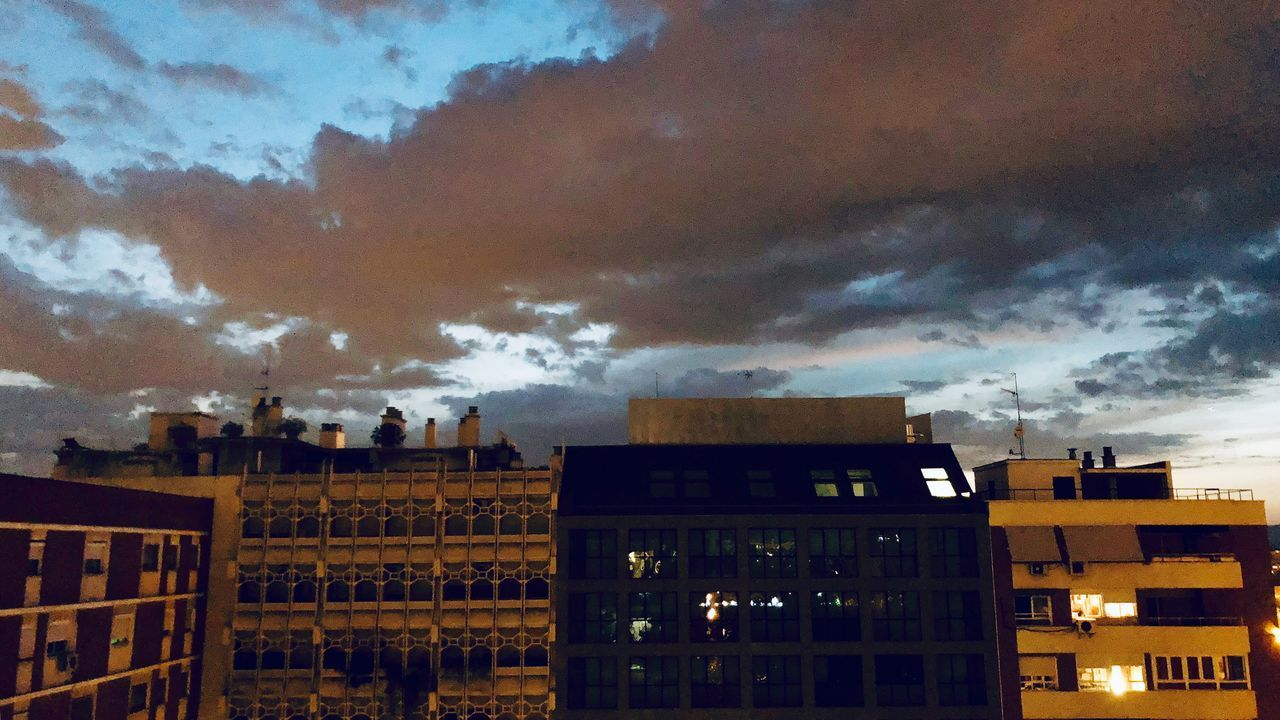 architecture, building exterior, built structure, cloud - sky, building, sky, city, residential district, no people, nature, dusk, illuminated, low angle view, outdoors, sunset, window, cityscape, night, overcast, apartment