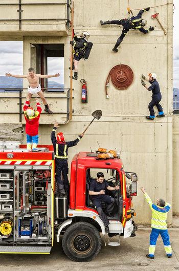 firemen Firemen Be Brave City Fire Engine Men Occupation Full Length Working Firefighter Teamwork Building Exterior Architecture