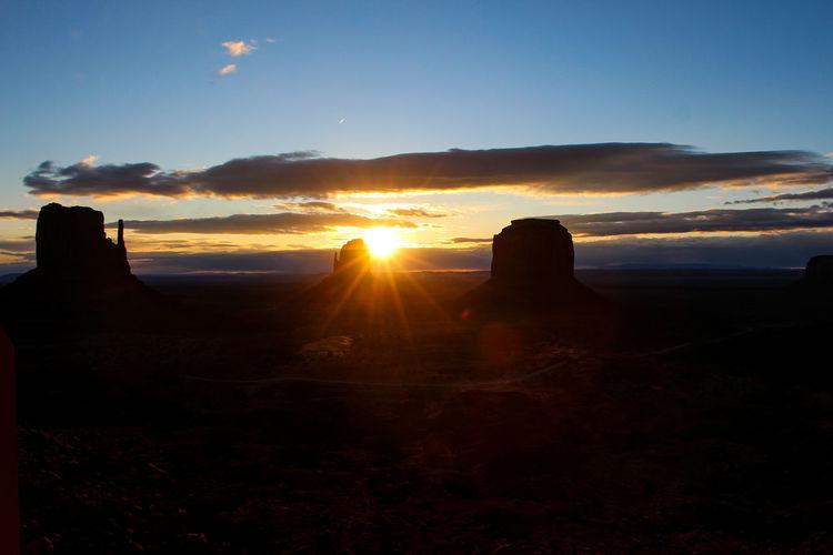Sky Sunset Cloud - Sky Tranquil Scene Beauty In Nature Scenics - Nature Tranquility Silhouette Nature Environment Rock Sunlight No People Non-urban Scene Idyllic Sun Land Landscape Sunbeam Lens Flare Outdoors Bright Sunrise Arizona Desert
