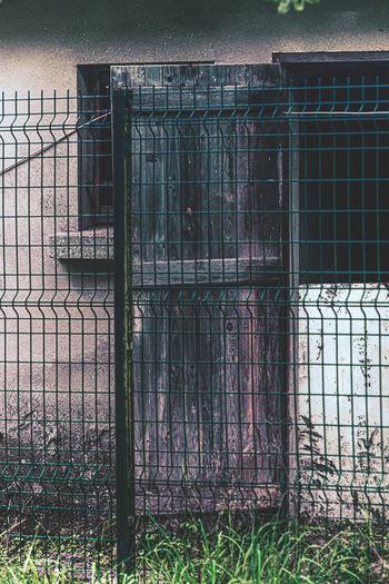 Closed metal gate of building