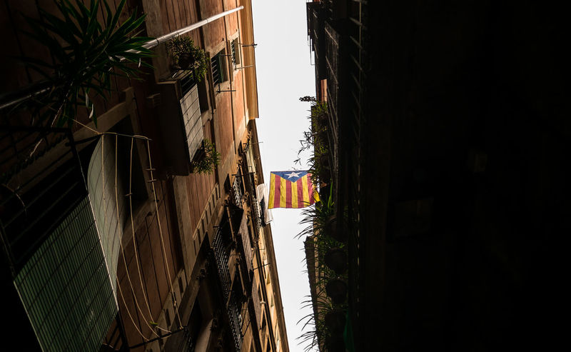 Catalan flags everywhere in Barcelona. The regional government has set a referendum on leaving Spain for 1 October 2017. Architecture Barcelona Catalunya Cloudy Cloudy Day Old Town SPAIN Travel Travel Photography Architecture Photography Building Exterior Built Structure City Day Flag Fujifilm Historic Looking Up No People Old Buildings Outdoors Sky Street Street Photography Streetphotography