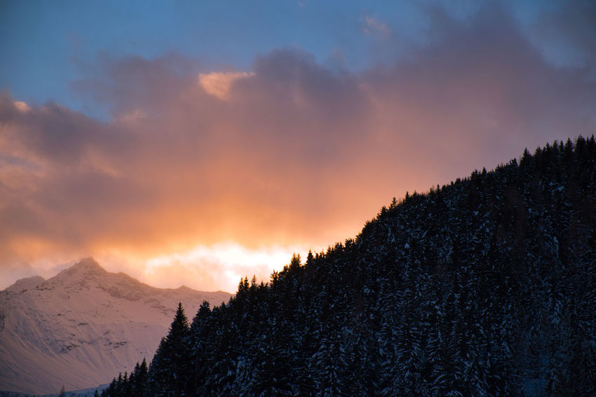 sunset closing. Beauty In Nature Cloud - Sky Cold Temperature Day Idyllic Landscape Mountain Mountain Range Nature No People Non-urban Scene Outdoors Scenics Silhouette Sky Snow Snowcapped Mountain Sunset Tranquil Scene Tranquility Tree Weather Winter
