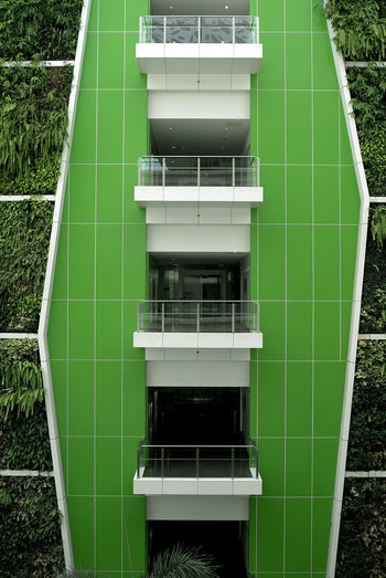 Green Color Pattern, Texture, Shape And Form Singapore Textures And Surfaces Architecture Balcony Blue Building Exterior Built Structure Day Leica Leica Camera Lines And Shapes Modern No People Outdoors Plant At The Wall Singapore Architecture Singapore Building Wall - Building Feature