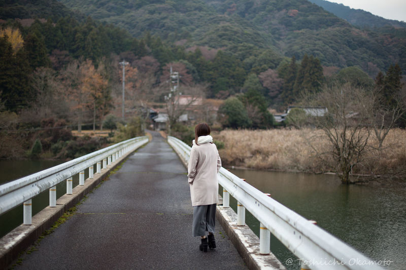 Rear view of woman on bridge