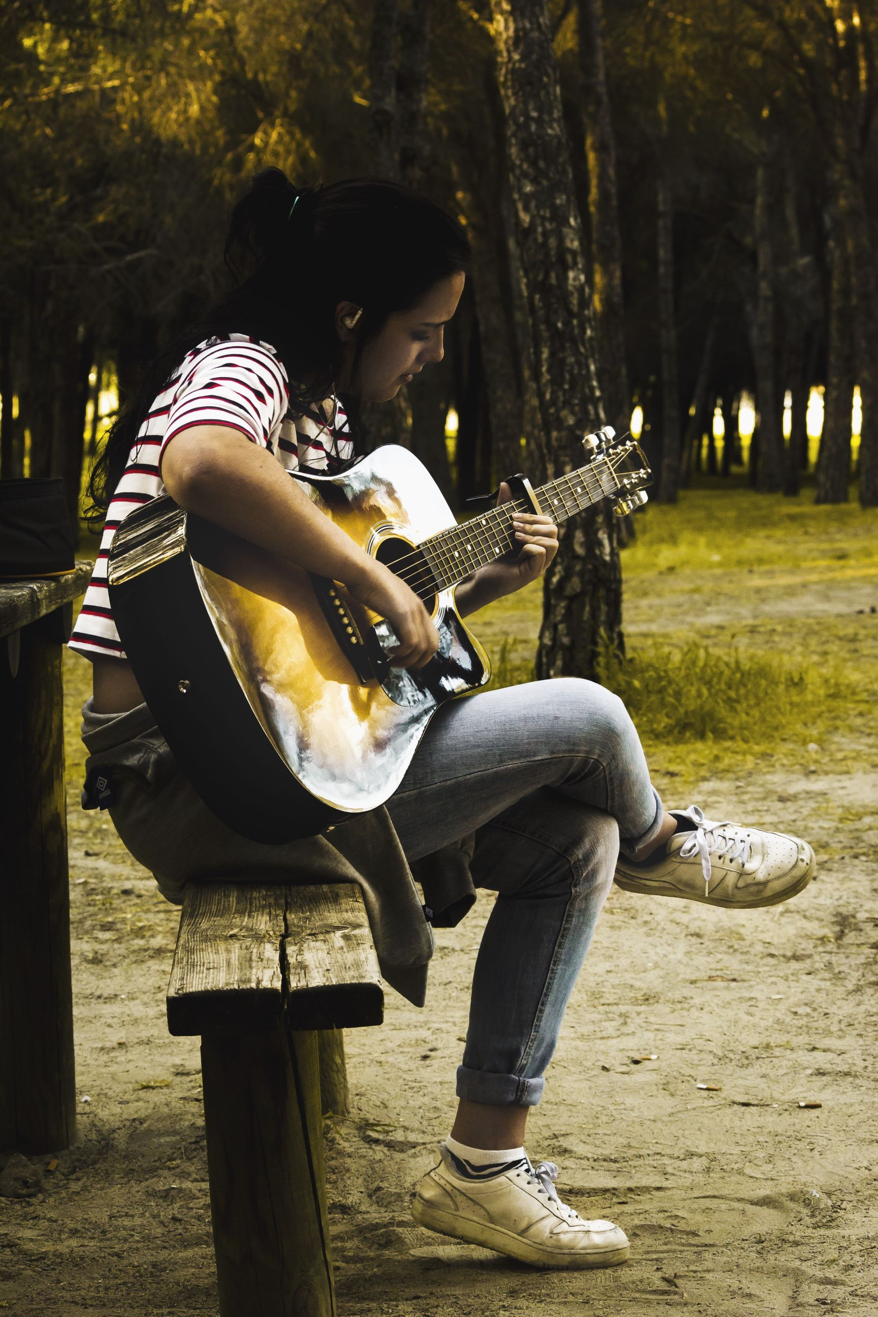 sitting, music, full length, adults only, guitar, one person, performance, one man only, arts culture and entertainment, only men, playing, people, adult, plucking an instrument, musical instrument, outdoors, musician, day, young adult