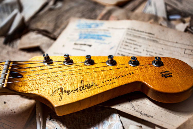 Music Still Life Wood - Material Arts Culture And Entertainment Musical Instrument Paper Close-up Indoors  No People String Instrument Focus On Foreground Sheet Book Publication Sheet Music Guitar Musical Equipment High Angle View Education Text Fender Fender Stratocaster EyeEmNewHere