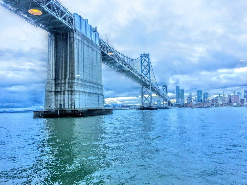 Oakland Bay Bridge Bay Architecture Built Structure Water Sky Cloud - Sky Waterfront Building Exterior City No People Bridge - Man Made Structure Outdoors