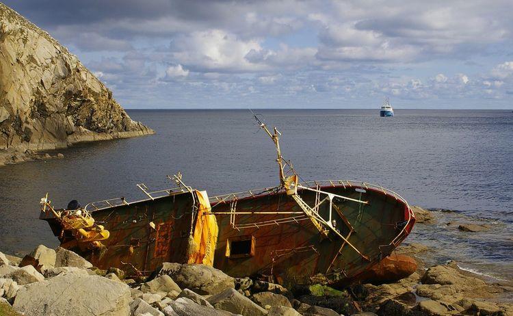St Kilda shipwreck. Sea Rock - Object Cliff Cloud - Sky Ocean Weathered Wreck Trawler Shipwreck Ship Wreck St Kilda Hirta