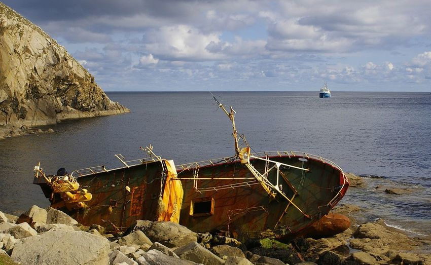 St Kilda shipwreck. Sea Rock - Object Cliff Cloud - Sky Ocean Weathered Wreck Trawler Shipwreck Ship Wreck St Kilda Hirta