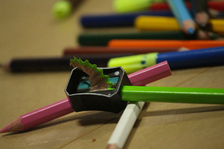 Close-up of pencils and sharpener on table