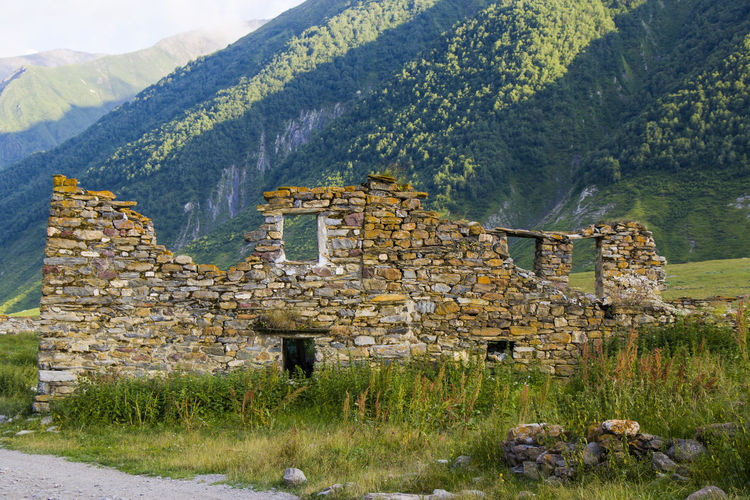 Old ruin building by mountains
