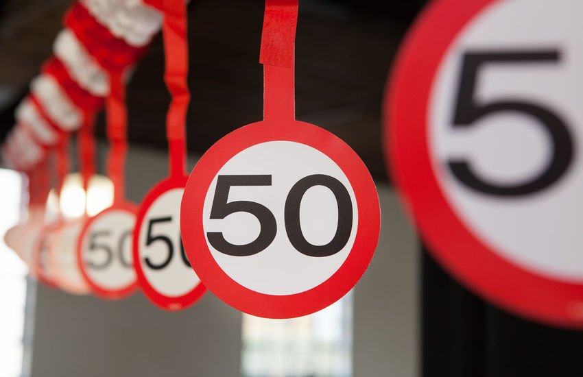 50 traffic speed limit signs in a row 50 Anniversary Birthday Circle Close-up Fifty Frame Hanging Many No People Number Red Row Sign Speed Limit Symbol Traffic Sign Year