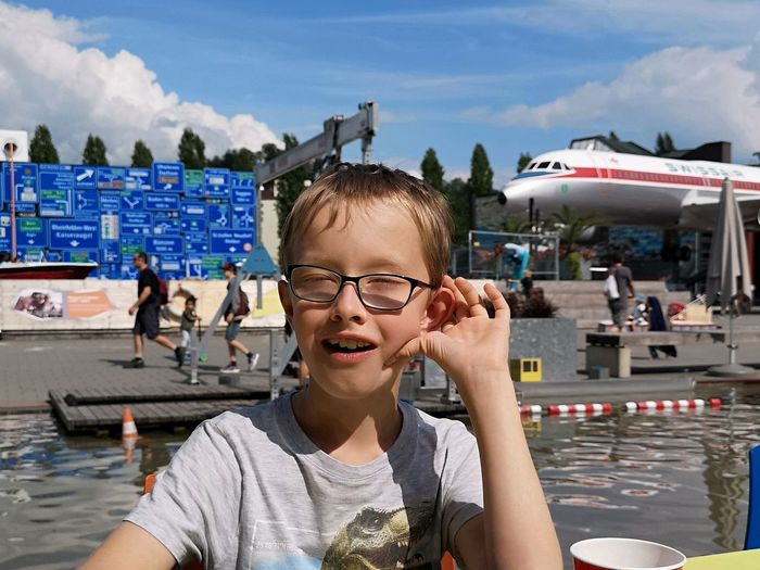 Oh, an airplane... Airplane Crash Joke Airplane Boy Casual Clothing Child Childhood Day Eyeglasses  Glasses Incidental People Leisure Activity Lifestyles Museum One Person Outdoors Portrait Real People Teenager Transportation