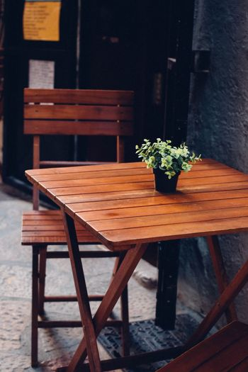Wooden table and chair on the street