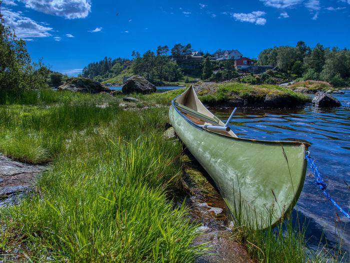 Beauty everywhere, just so nice to discover sights off the main raod. Canoe Nautical Vessel Water Transportation Plant Sky Mode Of Transportation Nature Moored Day Grass No People Land Tranquility Growth Tranquil Scene Cloud - Sky Scenics - Nature Beauty In Nature Tree Outdoors Rowboat