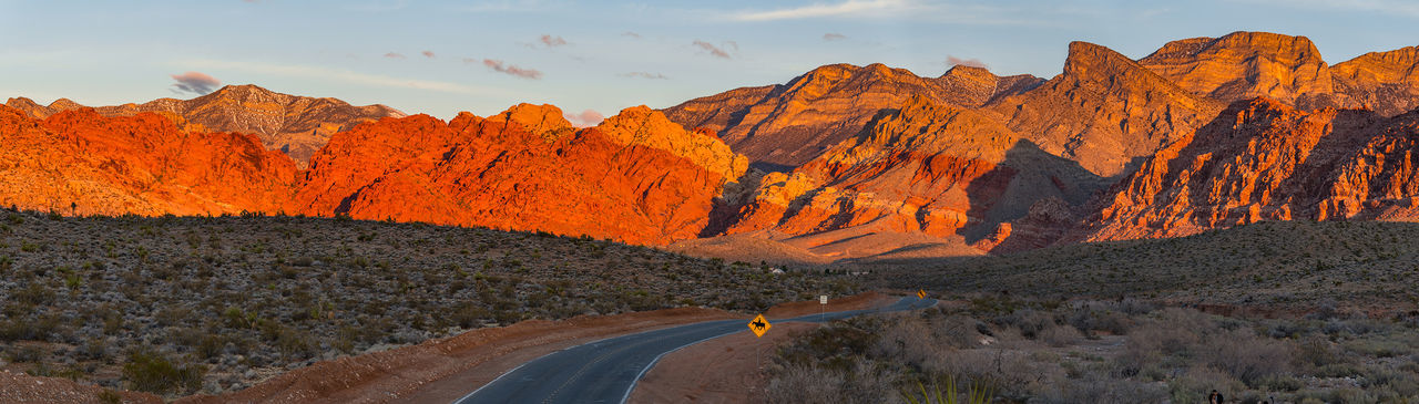 Sunrise @ Red Rock Canyon Beauty In Nature Day Desert Landscape Mountain Mountain Range Multi Colored Nature Nevada Nevada Desert No People Outdoors Panoramic Physical Geography Road Rock - Object Rock Formation Rural Scene Scenics Sky Sunlight Sunset Tree Winding Road Yellow