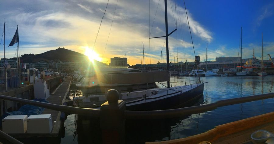Sunset over the yachts in the V&A waterfront, Cape Town... Nautical Vessel Moored Boat Harbor Sailboat Marina Yacht Mode Of Transport Transportation Sky Reflection Water Sea Travel Sunset Sunlight Cloud - Sky Mast Sun Outdoors