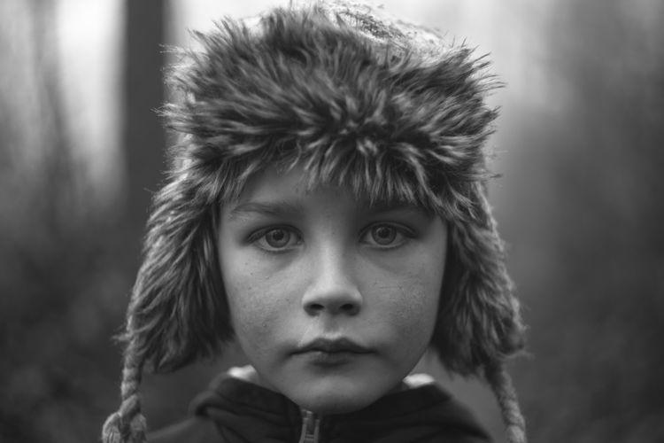 Close-Up Portrait Of Boy Wearing Hunter Cap